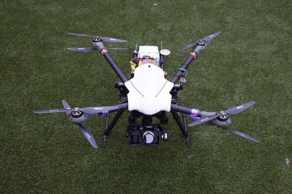 Octocopter drone sitting on grass
