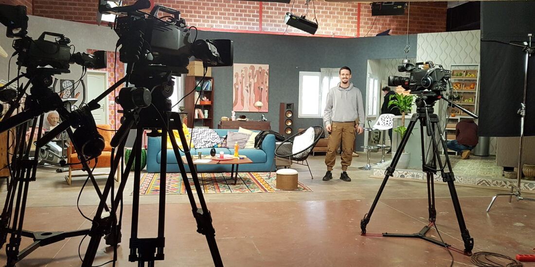 young man on tv set
